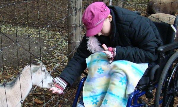 Carla Feeding a Goat